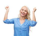 Smiling young woman with hands up — Stock Photo
