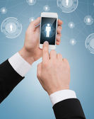 Businessman touching screen of smartphone — Stok fotoğraf