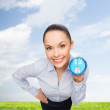Stock Photo: Smiling businesswoman with blue clock
