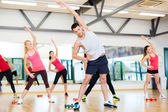 Group of smiling women stretching in the gym — ストック写真