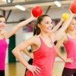 Stock Photo: Group of people working out with stability balls