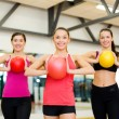 Foto Stock: Group of people working out with stability balls