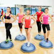 Stock Photo: Group of female doing aerobics with half ball