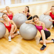 Stock Photo: Smiling people working out in pilates class
