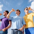 Stockfoto: Group of male friends with bottles of beer