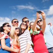 Group of friends taking picture with smartphone — Stock Photo #42116131