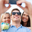 Stock Photo: Friends taking picture with smartphone camera