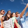Group of friends taking picture with smartphone — Stock Photo #42116147