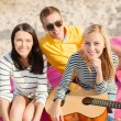 Stock Photo: Group of friends with guitar having fun on beach