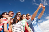 Group of friends taking picture with smartphone — Stock Photo