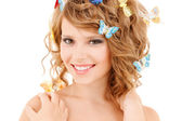 Happy teenage girl with butterflies in hair — Stok fotoğraf