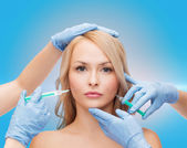 Woman face and beautician hands with syringes — Foto Stock