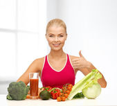 Smiling woman with organic food — Foto Stock