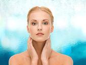 Beautiful woman touching her face skin — Foto Stock