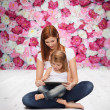 Happy mother with little girl and tablet pc — Stock Photo #42200709