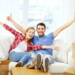 Smiling couple relaxing on sofa in new home — Stock Photo #42207085