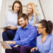 Team with tablet pc computer sitting on staircase — Stock Photo