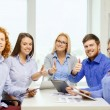 Stock Photo: Smiling team with table pc and papers working