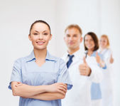 Smiling female doctor or nurse — Stock Photo
