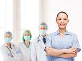 Smiling female doctor or nurse — Stock Photo