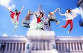 Group of teenagers jumping — Fotografia Stock