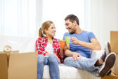 Smiling couple relaxing on sofa in new home — Foto Stock