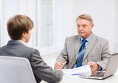 Older man and young man having meeting in office — Stock Photo