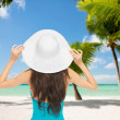 Woman sitting in swimsuit with hat — Stock Photo