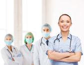 Lachende vrouwelijke arts of verpleegkundige met stethoscoop — Stockfoto