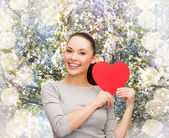 Smiling asian woman with red heart — Stock Photo
