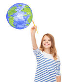 Cute little girl drawing with brush planet earth — Photo