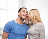 Smiling girlfriend telling boyfriend secret — Stock fotografie