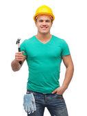 Smiling manual worker in helmet with hammer — Stok fotoğraf