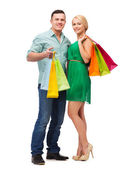 Smiling couple with shopping bags — Fotografia Stock