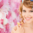 Happy teenage girl with butterflies in hair — Stock Photo #42419551