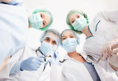 Group of doctors in operating room — Stock Photo