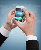 Businessman touching screen of smartphone — Foto Stock