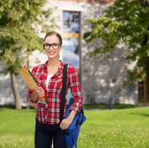 Female student in eyeglasses with bag and folders — Stock Photo