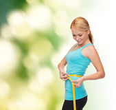 Sporty woman with measuring tape — Foto Stock