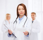 Calm female doctor with clipboard — Foto de Stock