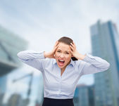 Angry screaming businesswoman outdoors — Stock Photo