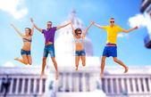 Group of friends or couples jumping — Stock Photo