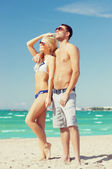 Couple on the beach — ストック写真