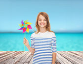 Smiling child with colorful windmill toy — Stock Photo