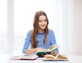 Happy smiling student girl with books — Foto Stock