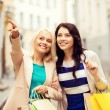 Girls with shopping bags in city — Stock Photo #42808885