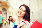 Girls with shopping bags in city — Stock Photo