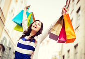 Woman with shopping bags in city — Stock Photo