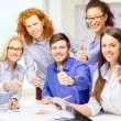 Creative team with papers showing thumbs up — Stock Photo
