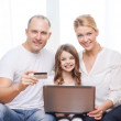 Parents and girl with laptop and credit card — Stock Photo #42818055